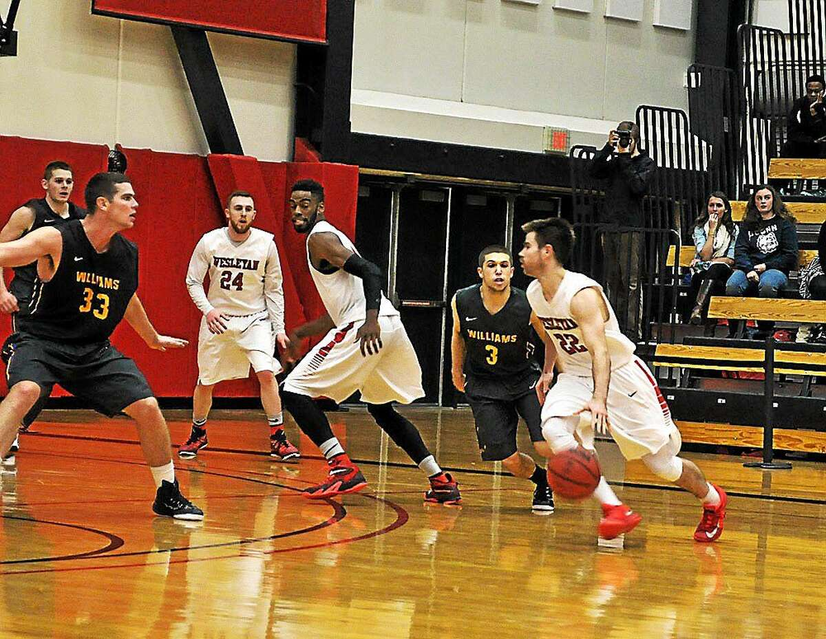 Photos courtesy of Wesleyan Athletic Department Wesleyan players, from left, Jack Mackey (24), Joseph Kuo, and Harry Rafferty (22) in action against Little Three rival Williams earlier this season. The Cardinals are off to a 10-2 start.