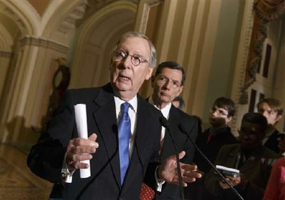 Senate Minority Leader Mitch McConnell, R-Ky., joined by Sen. John Barrasso, R-Wyo., right, the Republican Policy Committee chairman, talks with reporters Jan. 7. Photo: AP / AP