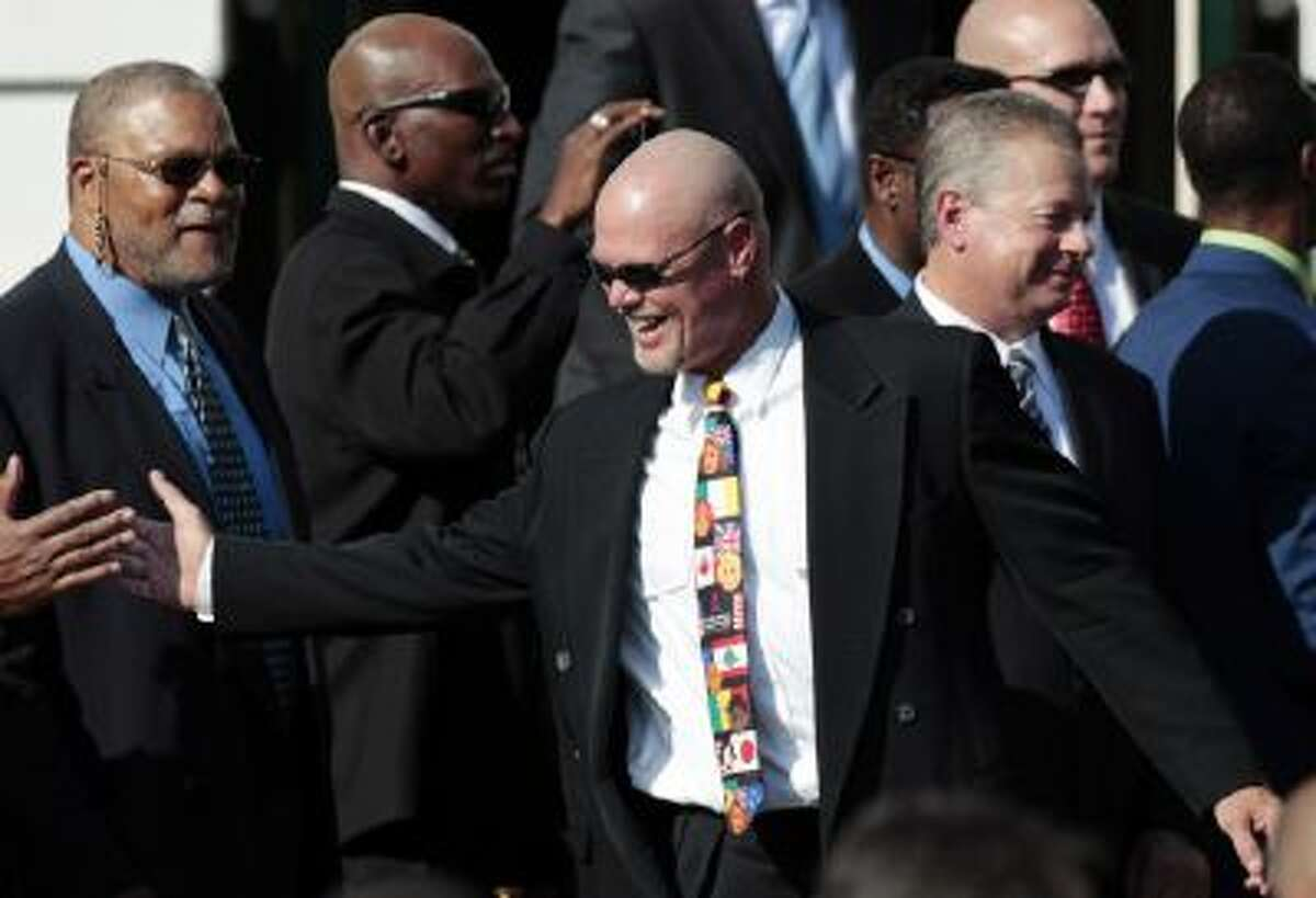 Plaintiff in the NFL concussion case and former Bears quarterback Jim McMahon, celebrates on stage after taking part in a ceremony honoring the 1985 Super Bowl XX Champions Chicago Bears.