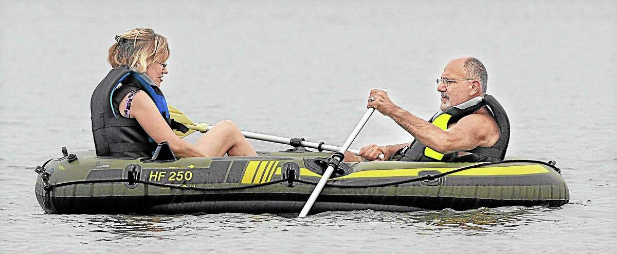 North Haven residents Louis Pasquarie, a retired state police officer and his wife, Mary tool around on Lake Pocotopaug in this file photo.
