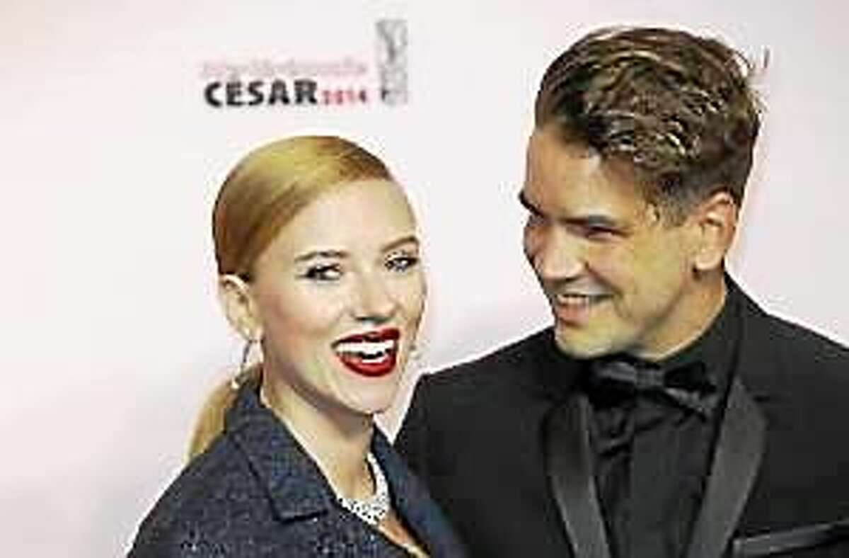 In this Feb. 28, 2014, file photo, actress Scarlett Johansson, left, and her partner Romain Dauriac arrive at the 39th French Cesar Awards Ceremony, in Paris.