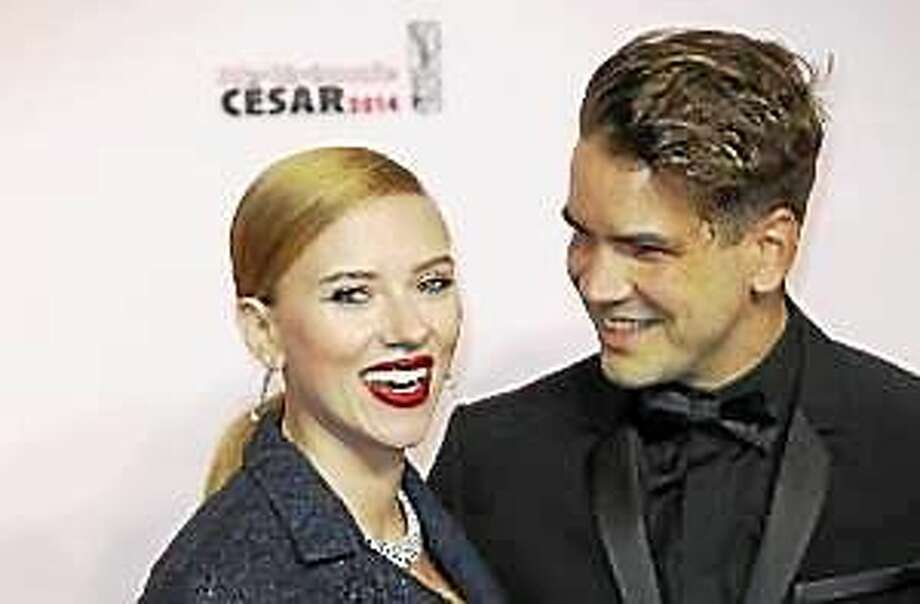 In this Feb. 28, 2014, file photo, actress Scarlett Johansson, left, and her partner Romain Dauriac arrive at the 39th French Cesar Awards Ceremony, in Paris. Photo: (Lionel Cironneau — The Associated Press)