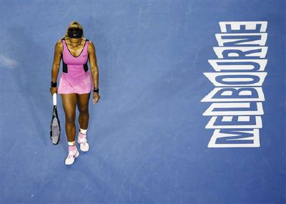Serena Williams of the United States walk on the court between points as she plays Ashleigh Barty of Australia during the first round match at the Australian Open tennis championship in Melbourne, Australia, Monday, Jan. 13, 2014.