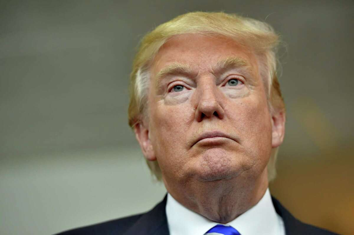 In this Aug. 27, 2015 photo, Republican presidential candidate Donald Trump listens during a news conference after speaking at the TD Convention Center, in Greenville, S.C.