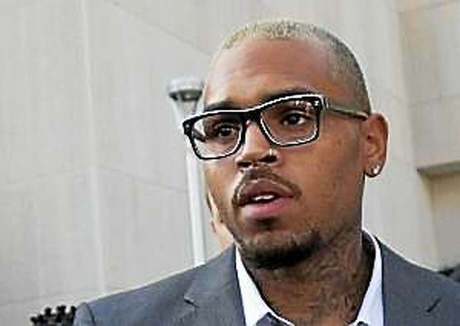 Singer Chris Brown leaves District of Columbia Superior Court in Washington, Tuesday, Sept. 2, 2014, after pleading guilty on a misdemeanor assault. Photo: (Manuel Balce Ceneta — The Associated Press) / AP net