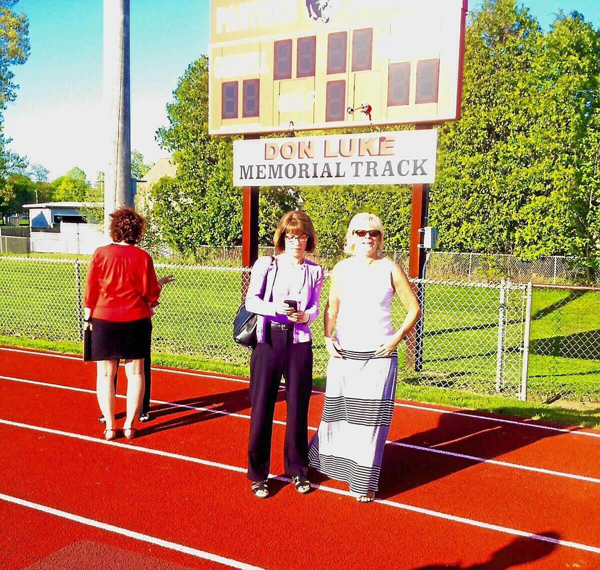 Cromwell residents, officials and family members gathered this week to honor the late Coach Don Luke, who passed away in January 2014, where they dedicated the track to him. Here his widow Patricia and their daughters Ivy and Melanie attended the unveiling.