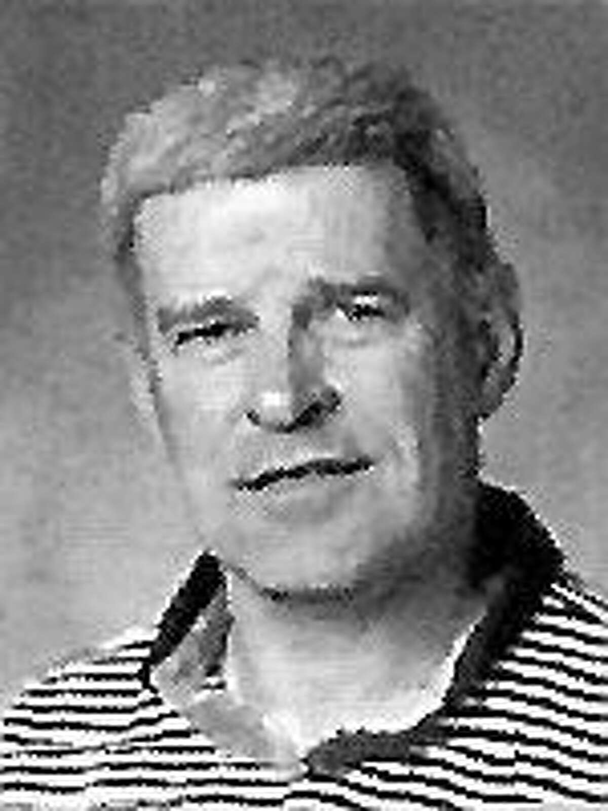 Cromwell High School track coach Don Luke is shown in the yearbook as a science teacher in 1994.