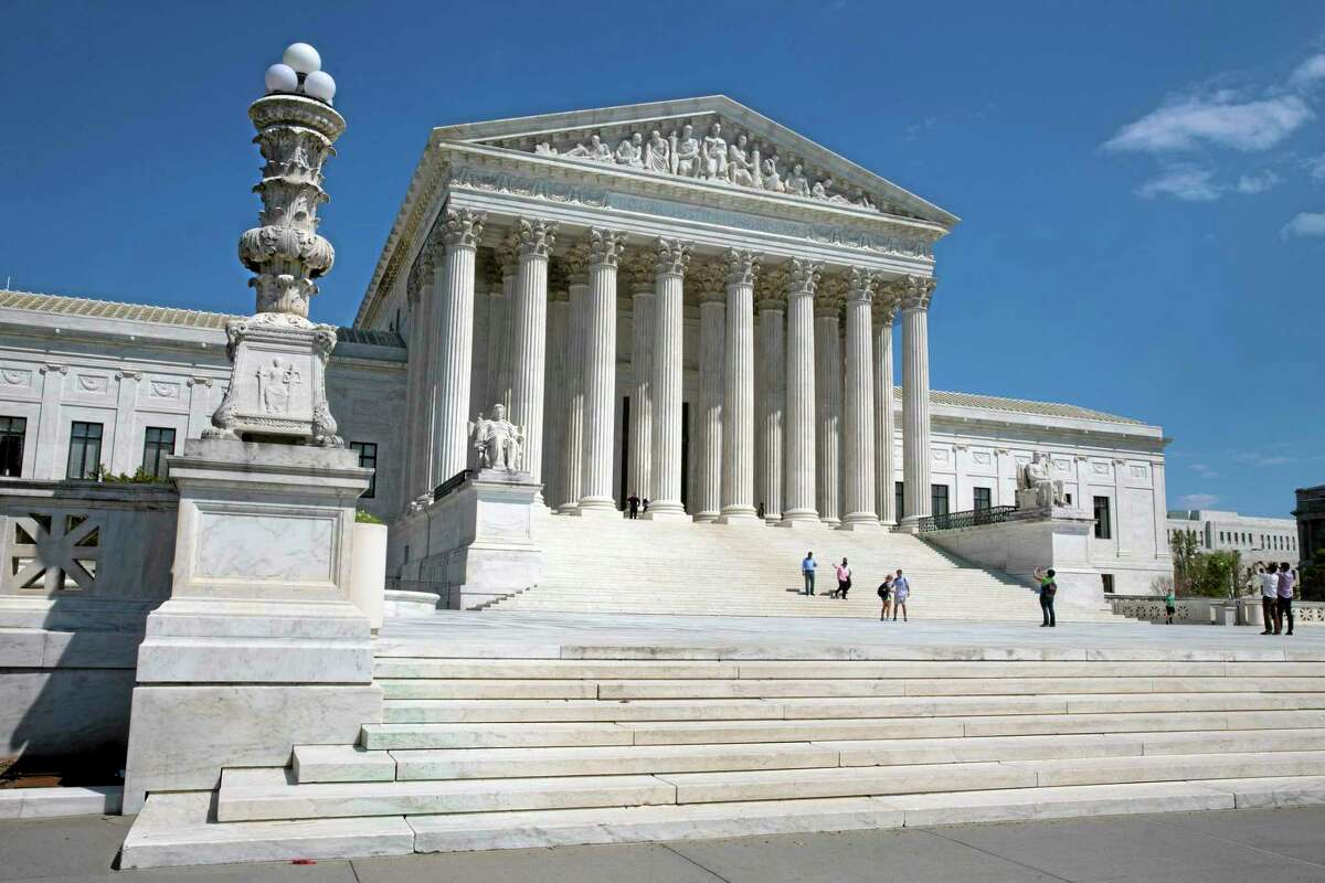 FILE - In this April 26, 2014 file photo, people walk on the steps of the U.S. Supreme Court in Washington. The Supreme Court said Monday that prayers that open town council meetings do not violate the Constitution even if they routinely stress Christianity. (AP Photo/Jacquelyn Martin)