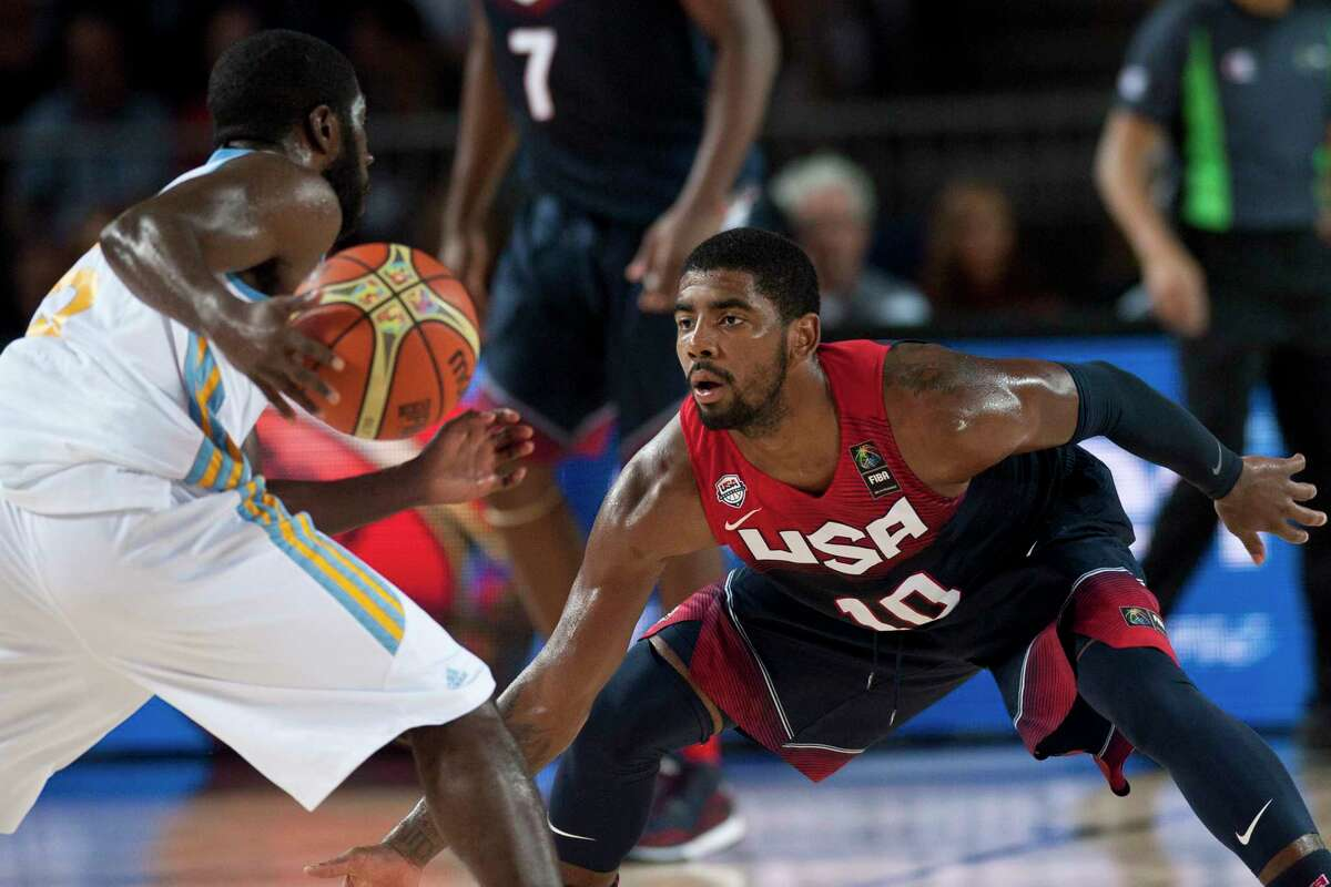 """Kyrie Irving defends Ukraine's Eugene """"Pooh"""" Jeter during Thursday's Group C Basketball World Cup game in Bilbao, Spain."""