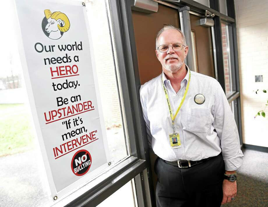 Eighth-grade American history teacher John Geary of Woodrow Wilson Middle School in Middletown is also the Student Council adviser, the boys basketball coach and founder of the Pride Patrol anti-bullying program. Photo: Arnold Gold — Middletown Press