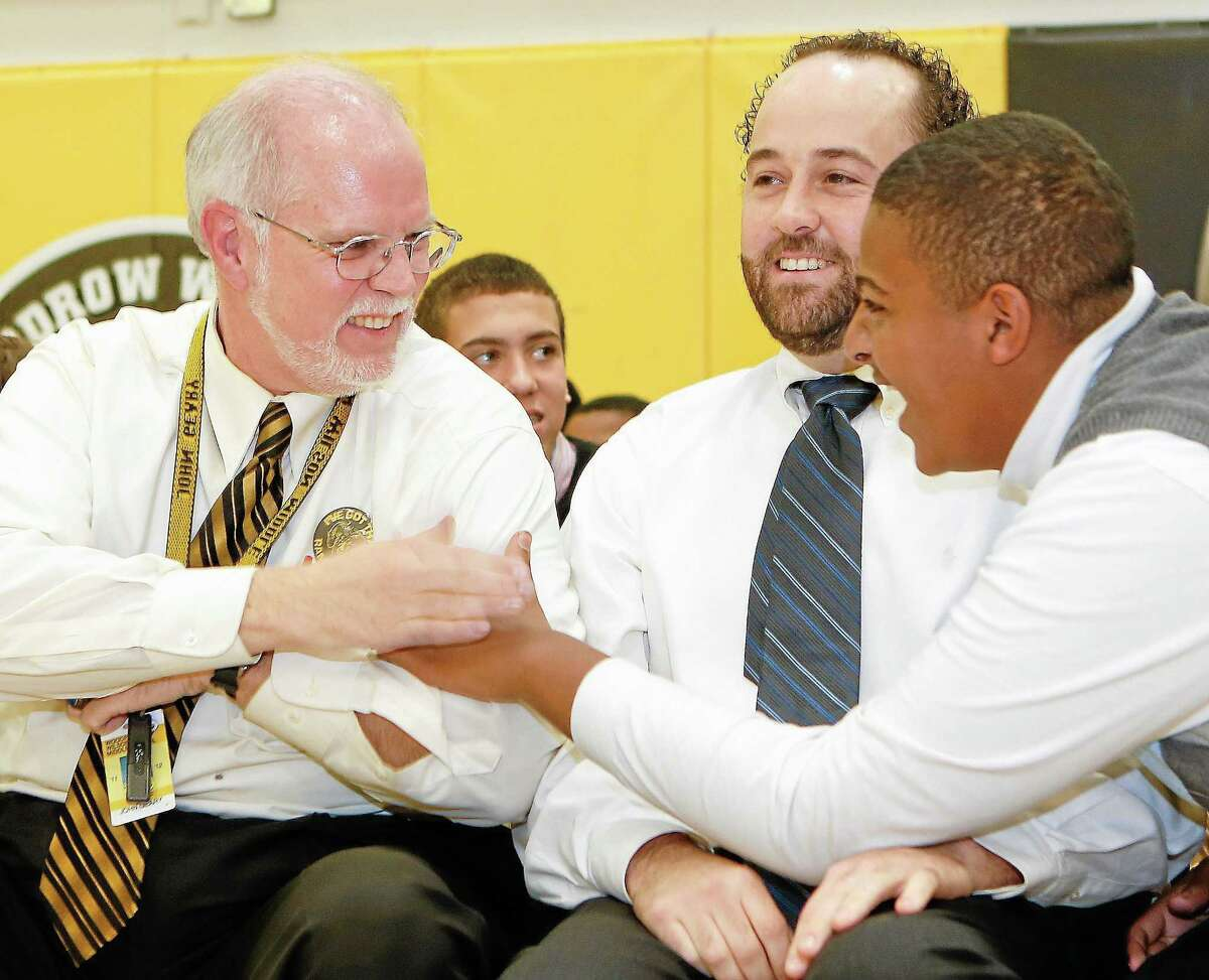 Basketball Coach John Geary, left and Assitant Coach Craig Labbadia, center, share in the excitement of Woodrow Wilson Middle School's 2012 Sportsmanship Award with Tony Petruzzello in this file photo.