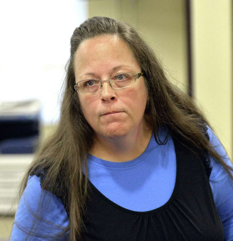 Rowan County Clerk Kim Davis listens to a customer following her office's refusal to issue marriage licenses at the Rowan County Courthouse in Morehead, Ky., Tuesday, Sept. 1, 2015. Although her appeal to the U.S. Supreme Court was denied, Davis still refuses to issue marriage licenses.  (AP Photo/Timothy D. Easley) Photo: AP / FR43398 AP