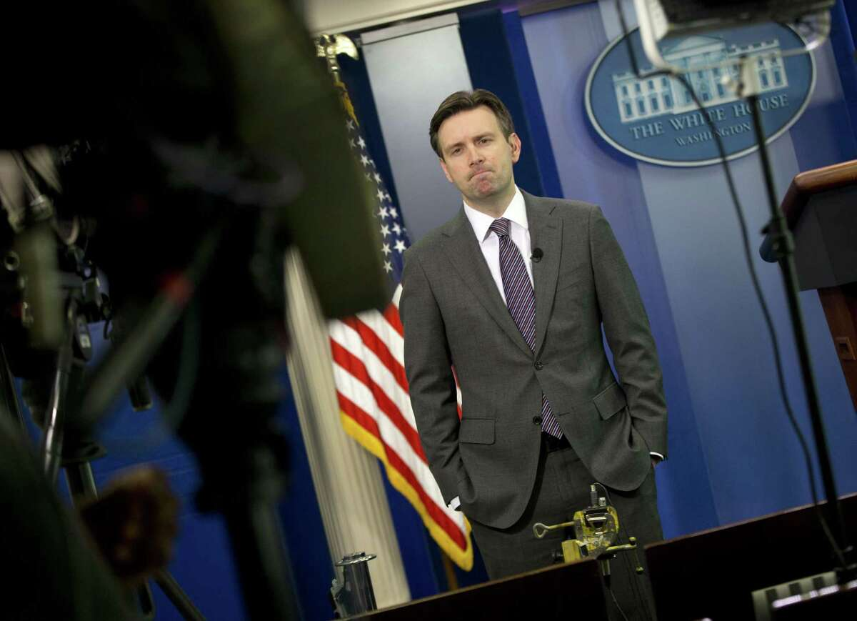 White House press secretary Josh Earnest waits to do a television interview with Fox News in the Brady Press Briefing Room of the White House in Washington, Wednesday, Jan. 7, 2015. President Barack Obama has condemned the shooting at the offices of Charlie Hebdo in Paris that has reportedly killed 12 people.