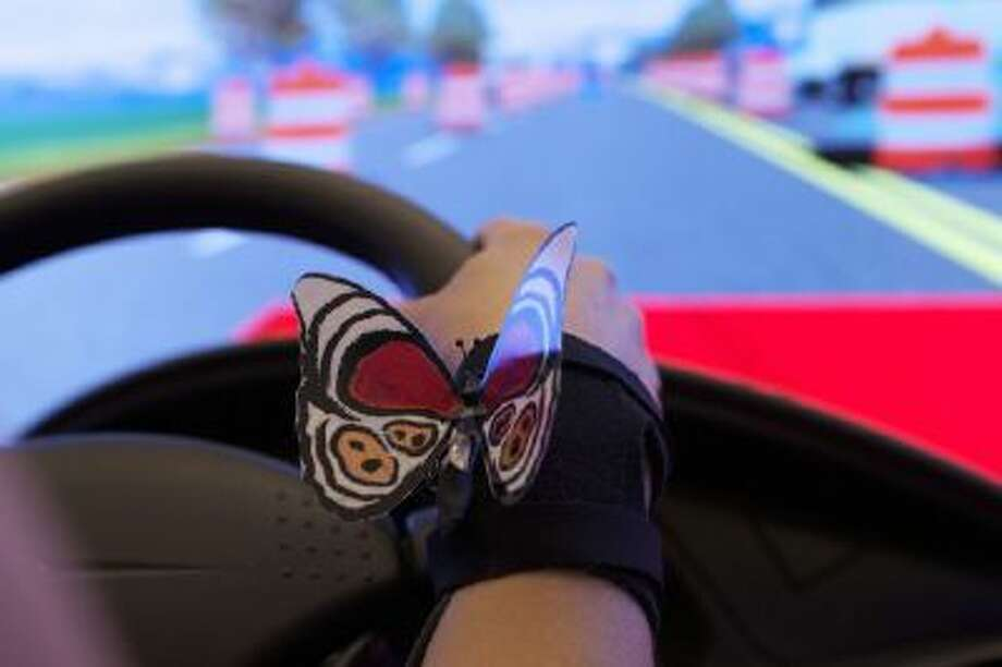 """Mood Wings,"" a butterfly-shaped set of wires attached to a sensor and worn on a wristband, beat at different rates depending on the wearer's stress level."