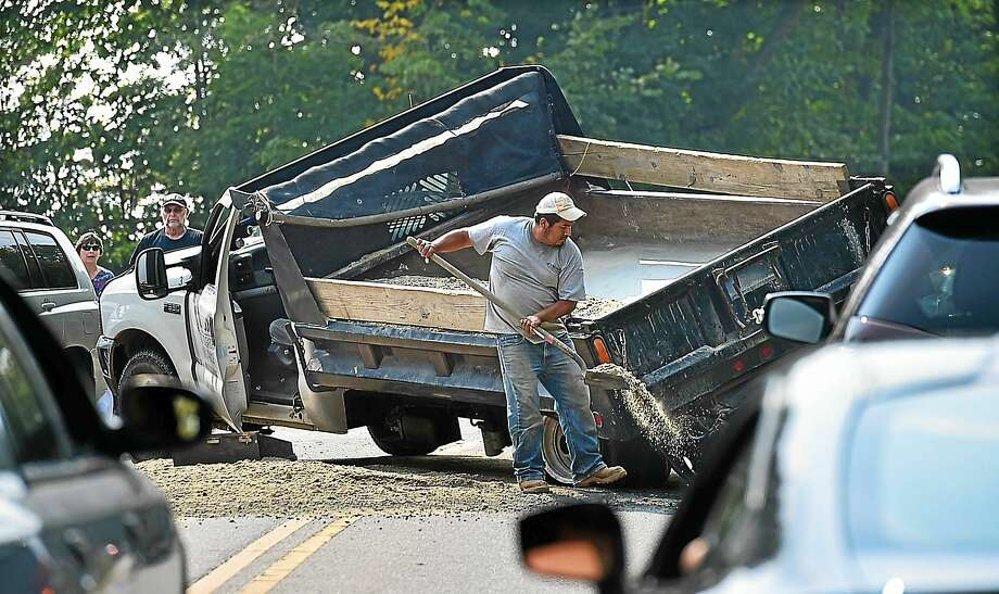 A truck blew out its rear driver-side tire, losing a load of gravel on Route 68 near Linmar Street in Durham Thursday. Photo: Catherine Avalone — New Haven Register  / New Haven RegisterThe Middletown Press