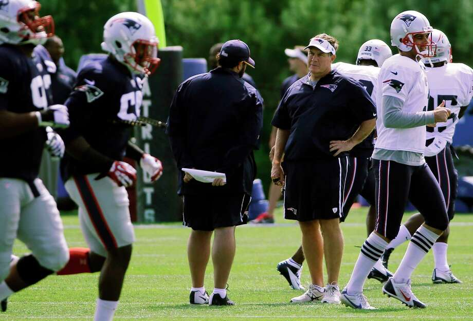 New England Patriots coach Bill Belichick watches his players on the practice field Wednesday in Foxborough, Mass. Photo: Elise Amendola — The Associated Press  / AP