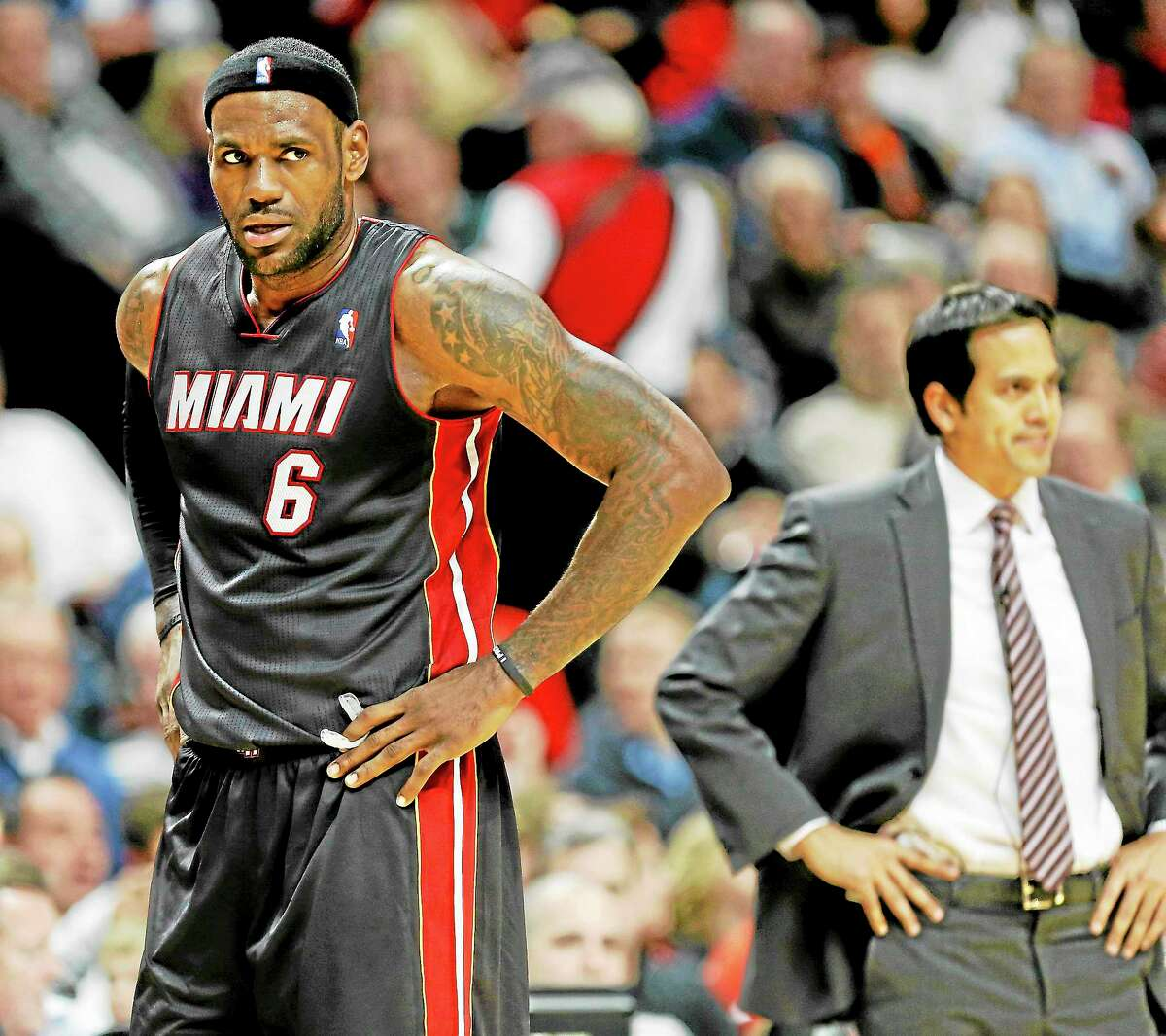 Miami Heat forward LeBron James reacts after his teammate was called for a foul against the Chicago Bulls during the second half of an NBA basketball game in Chicago, Thursday, Dec. 5, 2013. The Bulls defeated the Heat 107-87. (AP Photo/Kamil Krzaczynski)