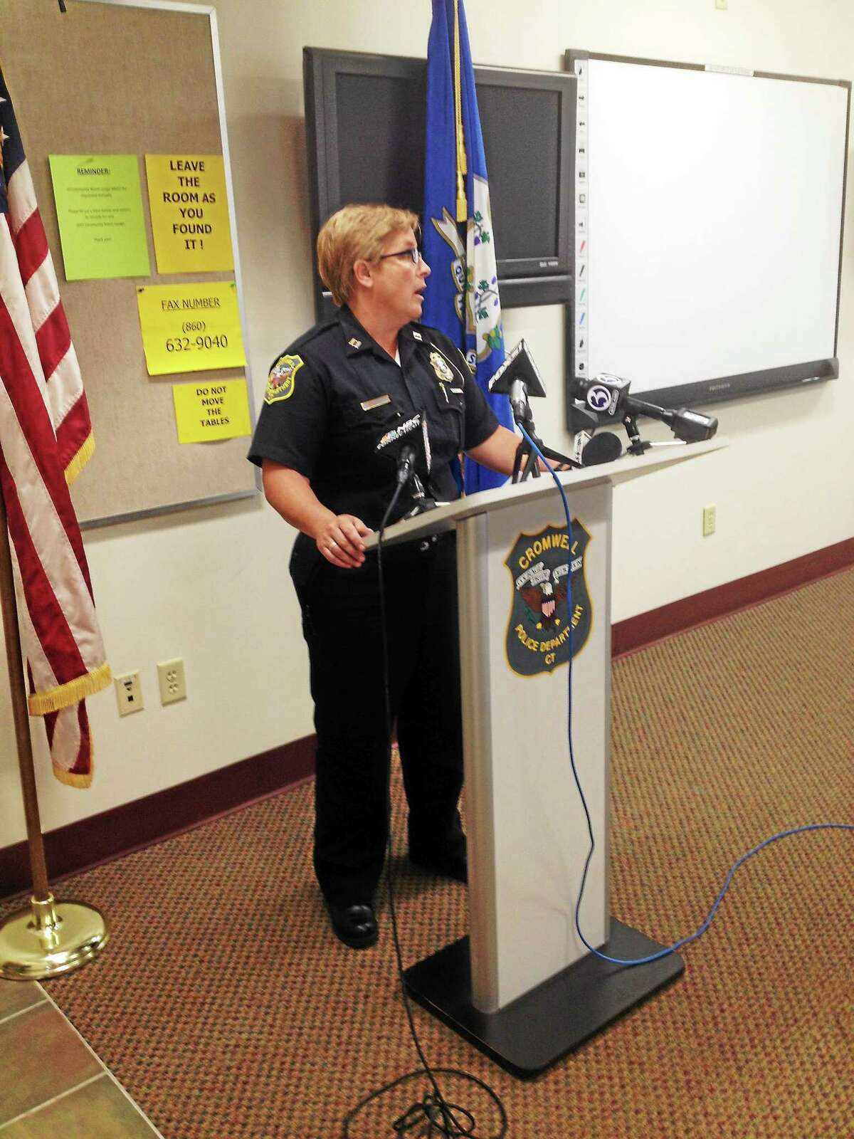 JEFF MILL -- THE MIDDLETOWN PRESS Cromwell police Capt. Denise Lamontagne speaks at a press conference Thursday on the probe of alleged hazing on the Cromwell/Portland football team.