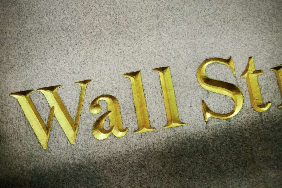 FILE - This Oct. 8, 2014, file photo, shows a Wall Street address carved in the side of a building, in New York. World stocks rose Thursday, Sept. 3, 2015, as a holiday in China gave investors a break from its torrid markets and the European Central Bank was expected to confirm its willingness to provide more stimulus to the eurozone, if needed.