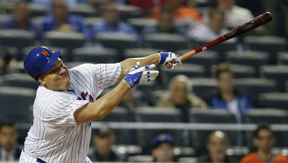 New York Mets Bartolo Colon loses his helmet as he bats in a baseball game against the Baltimore Orioles in New York, Tuesday, May 5, 2015. (AP Photo/Kathy Willens)