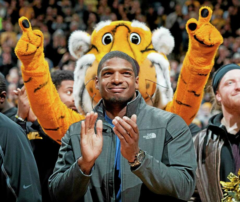 In this Feb. 15 file photo, Missouri's All-American defensive end Michael Sam claps during the Cotton Bowl trophy presentation at halftime of a college basketball game between Missouri and Tennessee in Columbia, Mo. Sam has been selected the winner of the Arthur Ashe Courage Award. The Missouri defensive end who likely will be drafted by an NFL team this weekend, will receive the award given to individuals who transcend sports at The ESPYs on July 16. Photo: L.G. Patterson — The Associated Press File Photo  / FR23535 AP