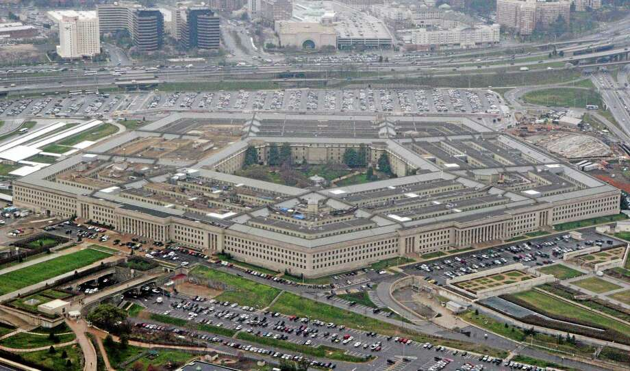 FILE - In this March 27, 2008, file photo, the Pentagon is seen in this aerial view in Washington. Is the U.S. spending enough money on defense, and is it spending it in the right ways? In the aftermath of the 9/11 terrorist attacks the money spigot was turned wide open, pouring hundreds of billions of dollars into the wars in Iraq and Afghanistan and expanding the armed forces. Now thatís changing, and an important issue in the election is whether budget cuts have gone too far.  (AP Photo/Charles Dharapak, File) Photo: AP / AP