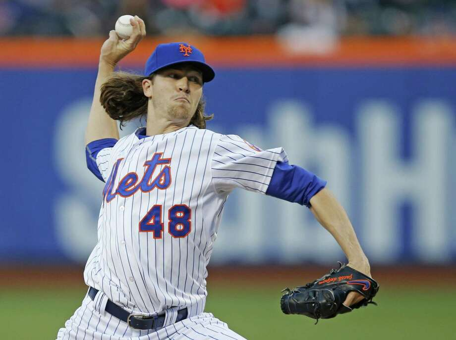 Mets starting pitcher Jacob deGrom delivers in the first inning of Wednesday's 5-1 win over the Orioles. Photo: Kathy Willens — The Associated Press  / AP