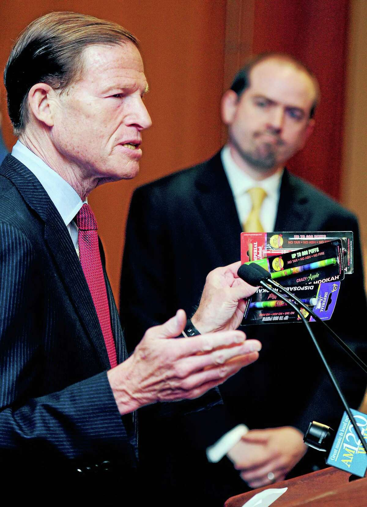 Senator Richard Blumenthal calls for further action restricting the sale and usage of e-cigarettes during a press conference at Smilow Cancer Hospital at Yale-New Haven on 4/28/2014. In the background is Dr. Benjamin Toll, Program Director, Smoking Cessation Service at Smilow Cancer Hospital at Yale-New Haven.