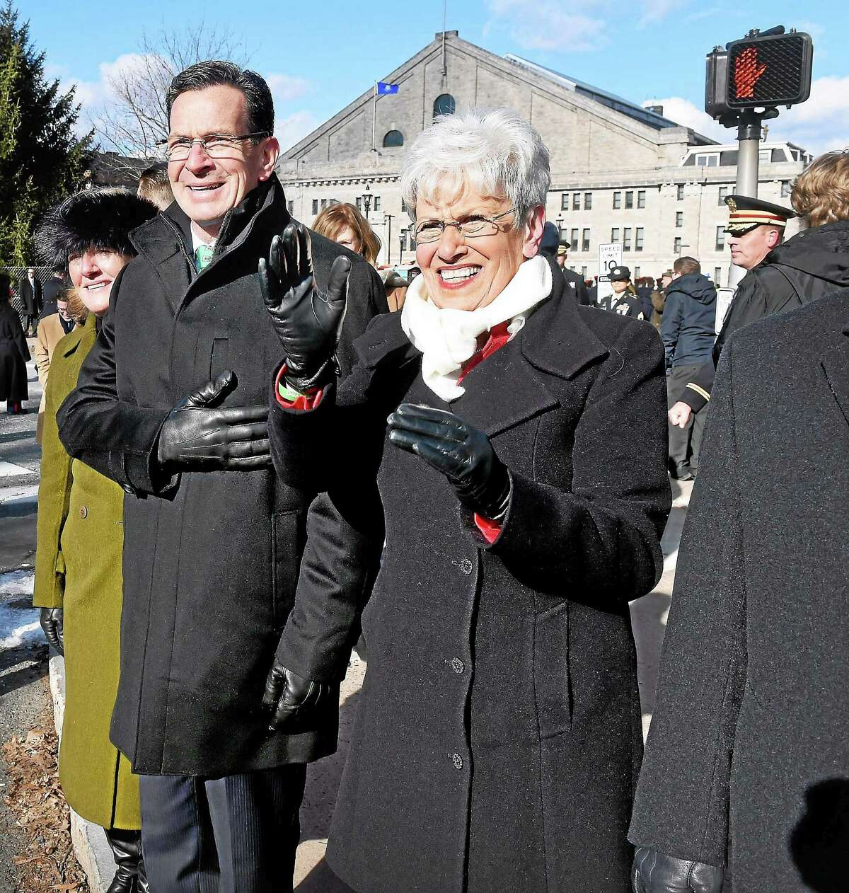 Governor Dannel P. Malloy (center) watches the Inaugural Parade with his wife, Catherine (left), and Lt. Governor Nancy Wyman (right) in front of the William A. O'Neill State Armory in Hartford on 1/7/2015.