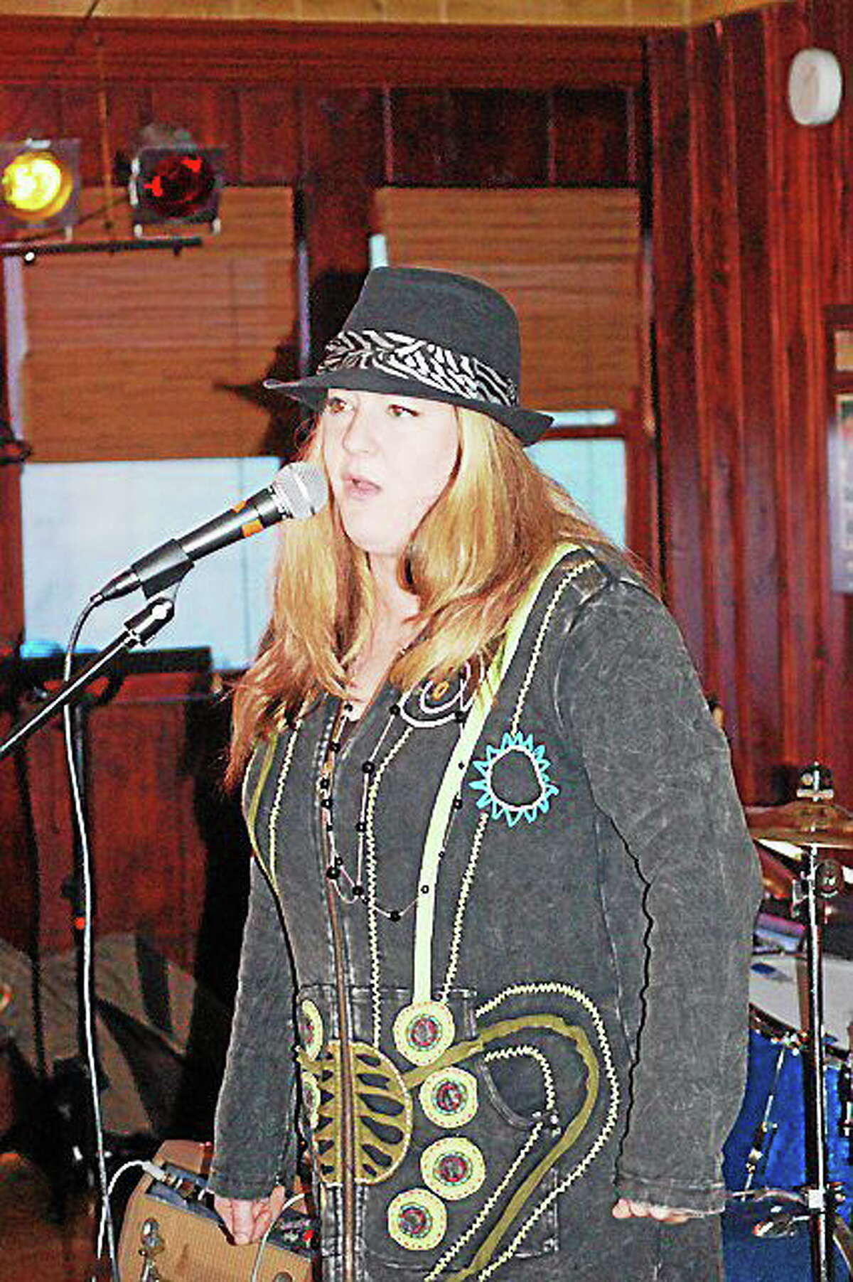 Photo by J. Forcella Lee-Ann Lovelace from Bad Rooster performs during a recent gig.