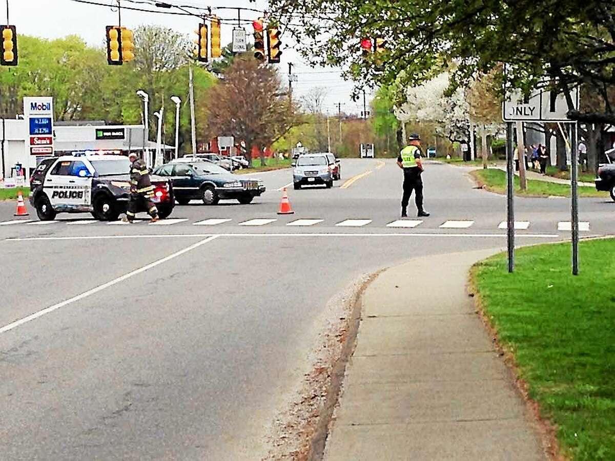 """Emergency responders help repair a """"major"""" gas leak at Main Street and Elm Street Wednesday morning."""