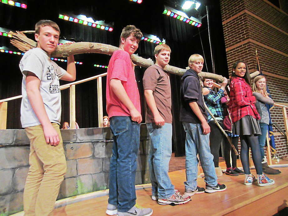 Submitted photo - Valley Regional High School Valley Regional Musical Productions cast and crew members help move a tree limb to be used to construct the set for the production of The Secret Garden on March 14-16l. Above, from left, are Greg Magruder,  Zach Crosby, Dan Leffingwell, Michael Leffingwell, Madison Estelle, Eryn Star, Olivia Wilkinson and Charlotte Boland. Photo: Journal Register Co.
