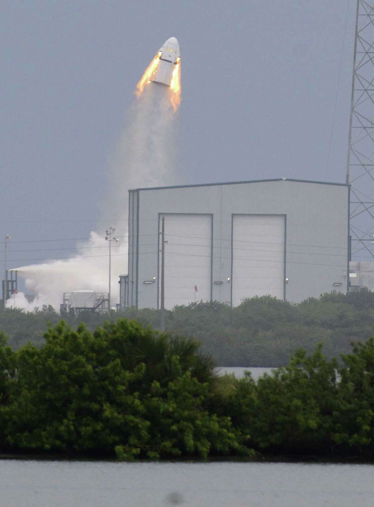 A SpaceX Dragon mock-up capsule blasts into the air, Wednesday, May 6, 2015 during a test flight in Cape Canaveral, Fla. The unmanned flight was testing a new, super-streamlined launch escape system for astronauts. The California-based company led by billionaire Elon Musk aims to launch U.S. astronauts to the International Space Station as early as 2017. (Craig Bailey/Florida Today via AP) NO SALES, MAGS OUT