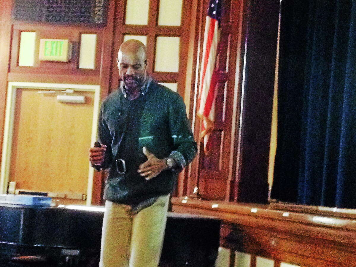 Acclaimed author and photographer Charles Smith Jr. speaks with fifth- and sixth-graders during a presentation Wednesday at the Brownstone Intermediate School in Portland.