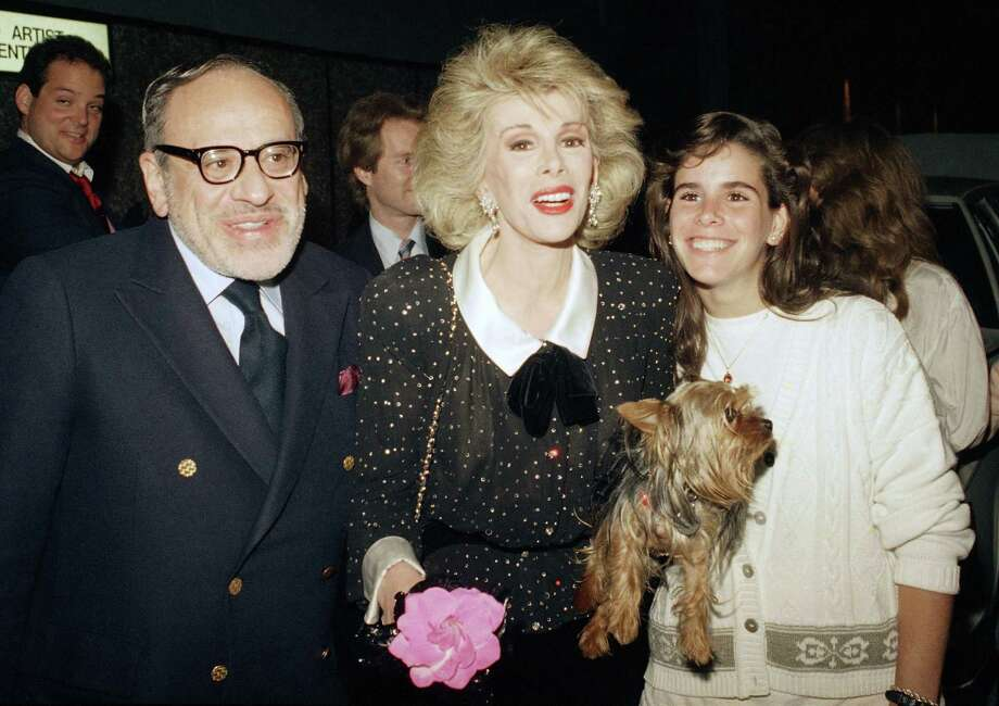 In this May 16, 1987 file photo shows entertainer Joan Rivers, center, with her husband Edger Rosenberg, left and daughter Melissa, at Fox Broadcasting Studios in Los Angeles. Rivers, the raucous, acid-tongued comedian who crashed the male-dominated realm of late-night talk shows and turned Hollywood red carpets into danger zones for badly dressed celebrities,  died Thursday, Sept. 4, 2014. She was 81. Rivers was hospitalized Aug. 28, after going into cardiac arrest at a doctor's office. Photo: (Robert Galbraith — The Associated Press) / AP