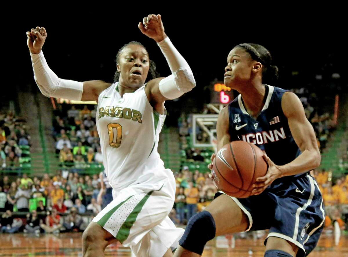 Baylor's Odyssey Sims defends UConn's Moriah Jefferson during the first half of the top-ranked Huskies' 66-55 win over the No. 7 Lady Bears on Monday in Waco, Texas.