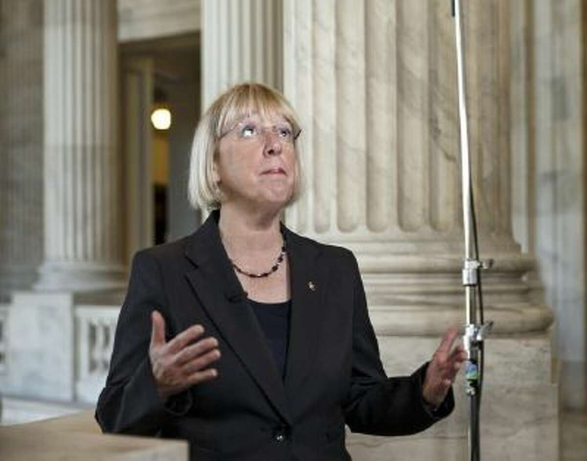 Senate Budget Committee Chairwoman Patty Murray, D-Wash., the architect of a bipartisan budget deal negotiated with Rep. Paul Ryan, R-Wis., the House Budget Committee chairman, discusses the compromise spending plan during a television news interview on Capitol Hill in Washington, Wednesday, Dec. 18, 2013.
