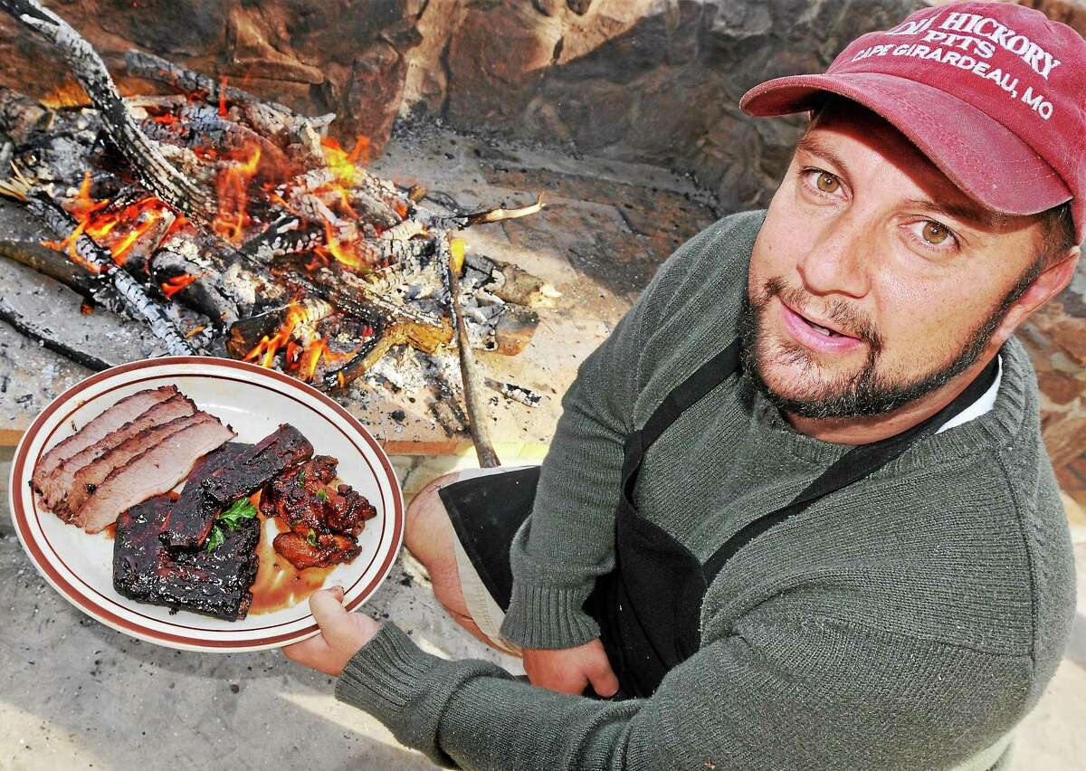 Middletown resident Chris Szewczyk, owner of Taino Smokehouse on South Main Street, is shown in this file photo.