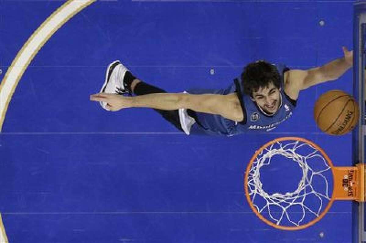 Minnesota Timberwolves' Ricky Rubio in action an NBA basketball game against the Philadelphia 76ers, Monday, Jan. 6, 2014, in Philadelphia.