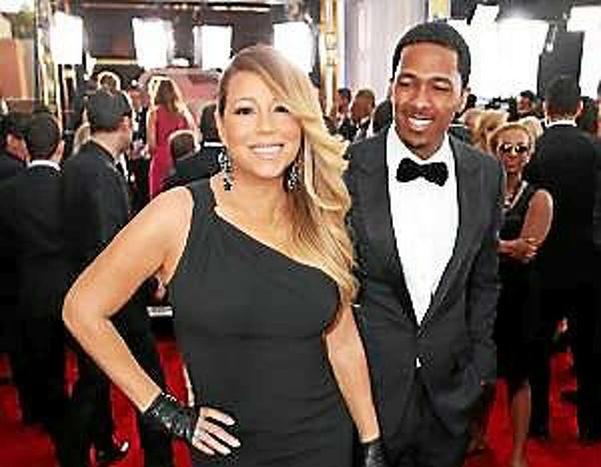 This Jan. 18, 2014, file photo shows Mariah Carey, left, and Nick Cannon at the 20th annual Screen Actors Guild Awards in Los Angeles.
