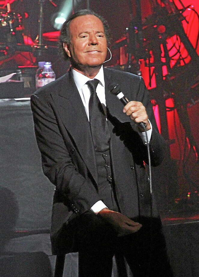Photo by John Atashian Spanish singer and songwriter Julio Iglesias is shown on stage at the MGM Grand Theater at Foxwoods during his live concert performance on Friday, May 2. The 70-year-old vocalist has sold more than 300 million records worldwide during his 46-year music career. Photo: John Atashian / John Atashian