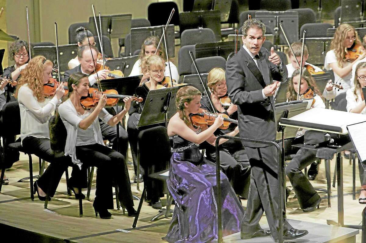 Conductor Edward Cumming gives a thumbs up for the audience participation during the strings performance of Middletown High Goes to the Symphony in this file photo.