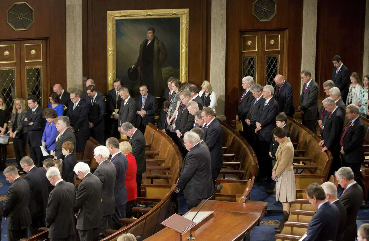 Members of the House of Representatives bow their heads during a prayer as they gather for opening session of the 114th Congress on Capitol Hill in Washington, Tuesday, Jan. 6, 2105, as Republicans assume full control. House Speaker John Boehner, R-Ohio, is expected to win a third despite a tea party-backed effort to unseat him, and Sen. Mitch McConnell, R-Ky., ascends to majority leader of the Senate after Democrats lost control the wake of November's midterm elections. (AP Photo/Pablo Martinez Monsivais )