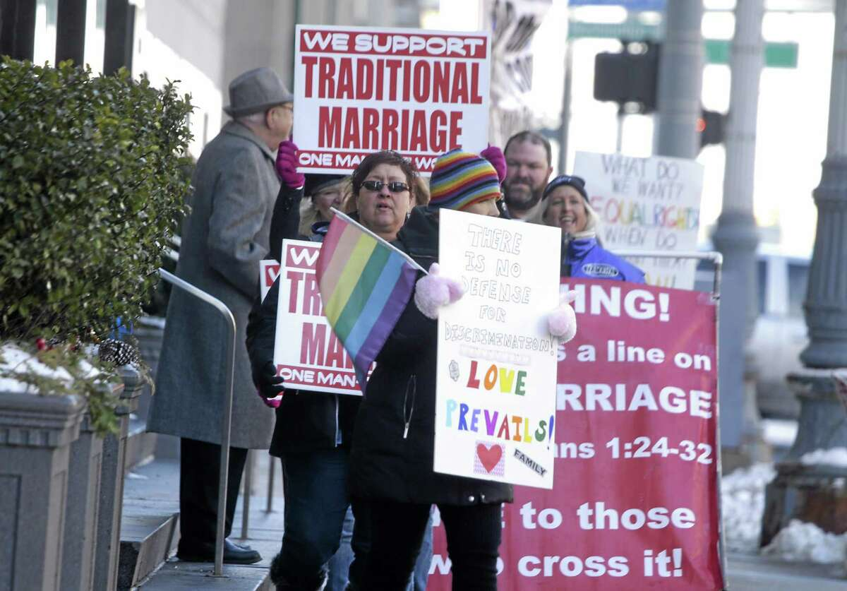 Supporters and protesters chant before closing arguments in the trial of two Detroit-area nurses, Jayne Rowse and April DeBoer, challenging Michigan's gay-marriage ban at the Theodore Levin Federal Court in Detroit Friday March 7, 2014.