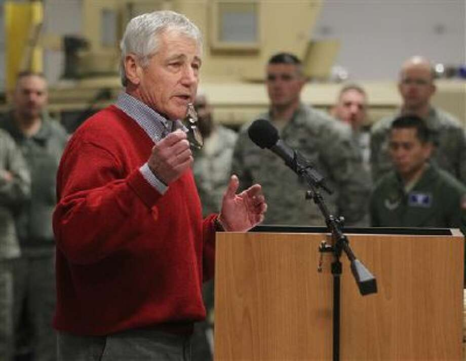 Defense Secretary Chuck Hagel speaks Thursday with airmen of the 20th Air Force 90th Missile Wing during a trip to F.E. Warren Air Force Base in Cheyenne, Wyo. It was the first time since 1982 that a defense secretary has visited the nuclear missile base. Photo: ASSOCIATED PRESS / AP2014
