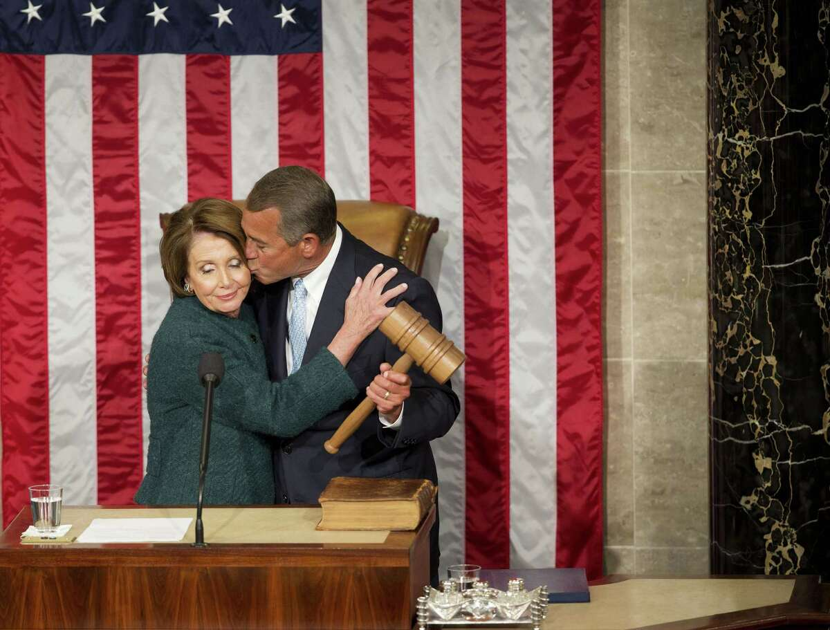 House Speaker John Boehner of Ohio kisses House Minority Leader Rep. Nancy Pelosi of Calif. after being re-elected to a third term during the opening session of the 114th Congress, as Republicans assume full control for the first time in eight years, Tuesday, Jan. 6, 2015, on Capitol Hill in Washington.