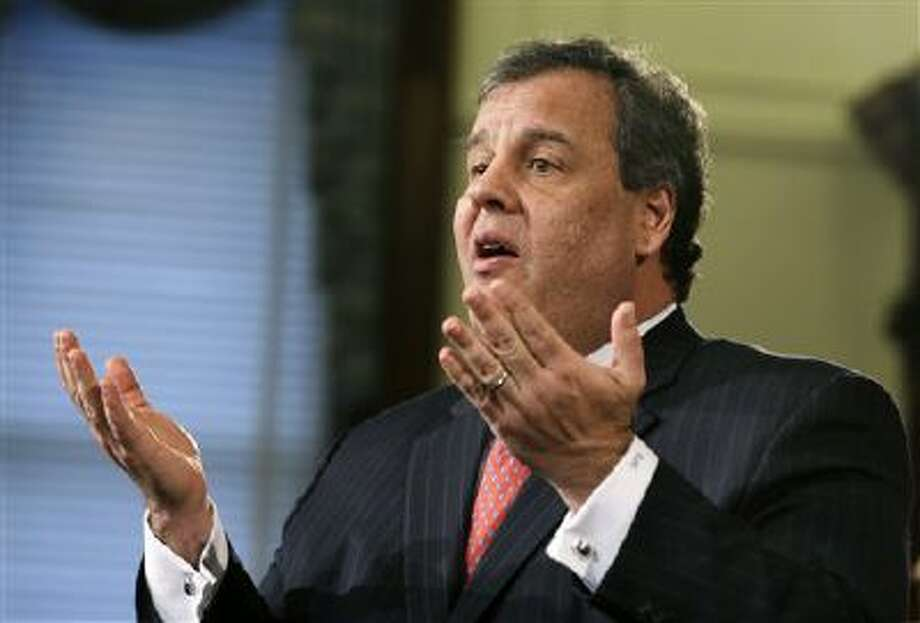 New Jersey Gov. Chris Christie answers a question during a news conference Thursday at the Statehouse in Trenton. The Christie administration stands accused of closing lanes on the George Washington Bridge, linking New York and New Jersey, in order to create a huge traffic backup as retribution against a local mayor for not endorsing the governor's re-election. Photo: AP / AP