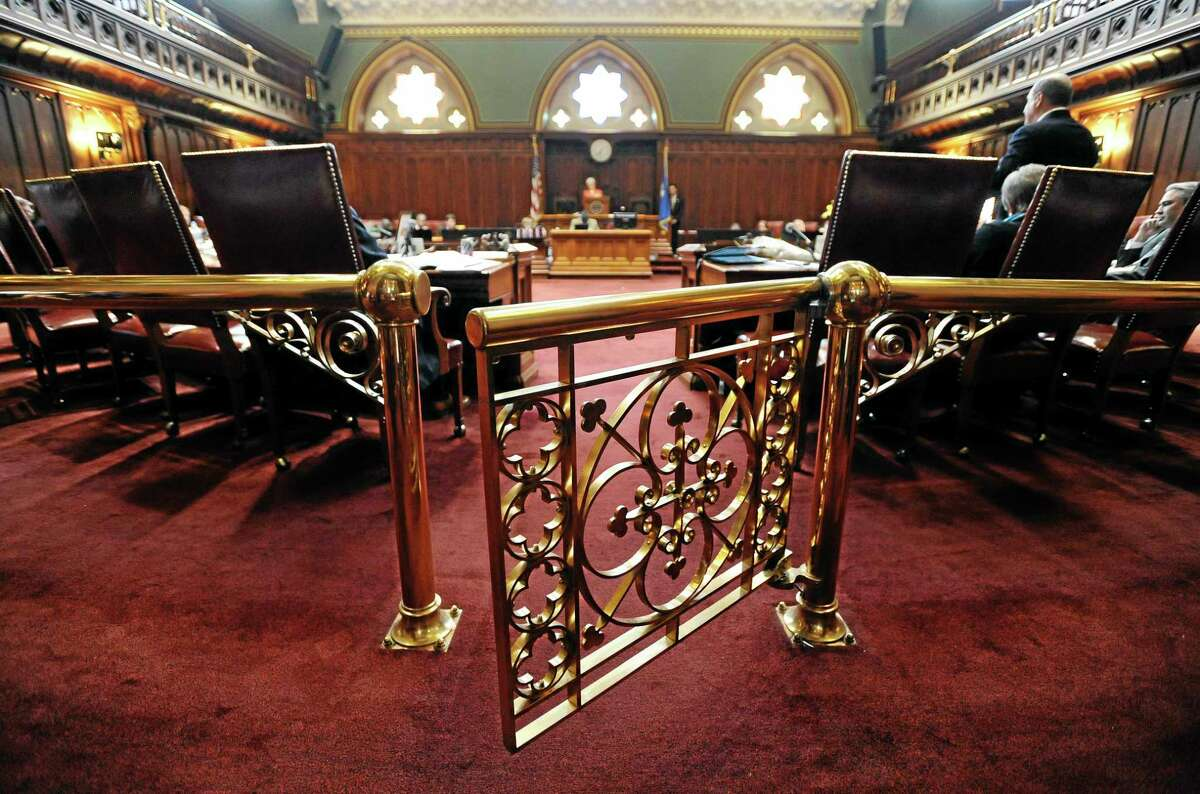 A gate to the state Senate Chamber swings close at the Capitol on the final day of session, Wednesday, May 7, 2014, in Hartford, Conn. (AP Photo/Jessica Hill)