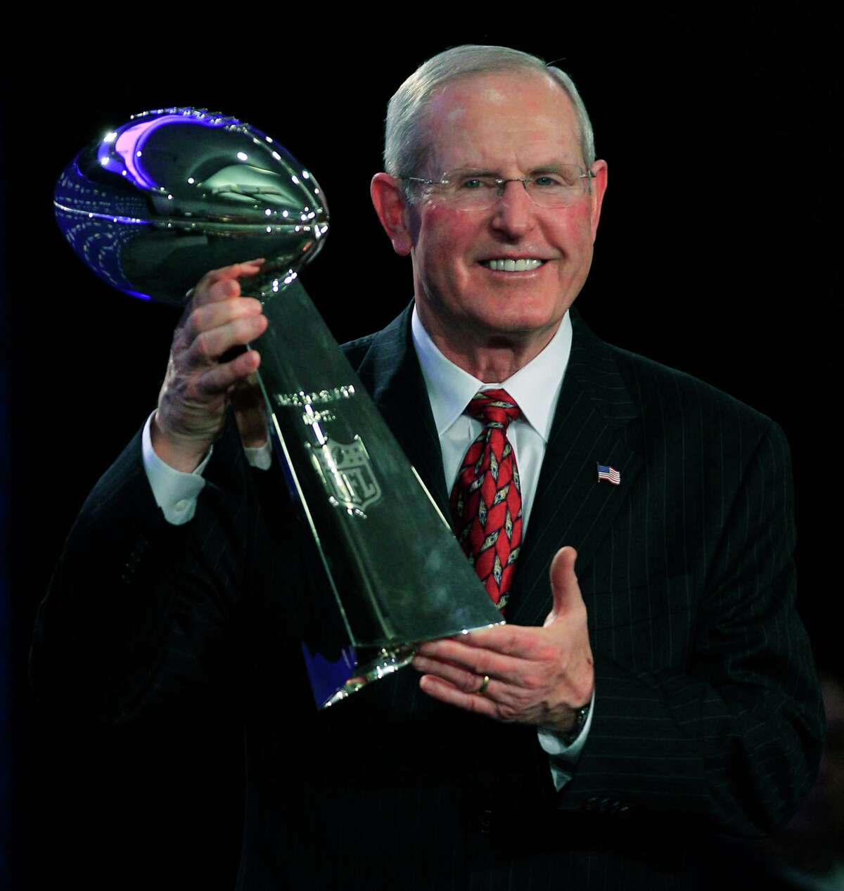 New York head coach Tom Coughlin holds up the Vince Lombardi Trophy during a news conference after the Giants defeated the Patriots to win Super Bowl XLVI in 2012 in Indianapolis.