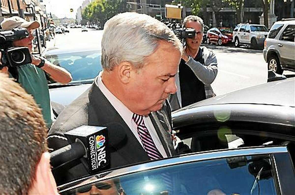 File - Former Gov. John G. Rowland leaves the Federal Courthouse in New Haven Sept. 19, 2014.